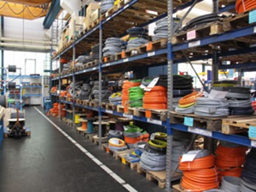 Picture of a warehouse has multiple chainflex® cables in stock.